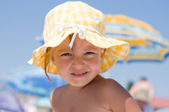 Girl on beach. Beautiful little girl with sun hat on beach Stock Image
