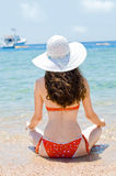 Girl on the beach. A young beautiful girl on the beach Stock Photography