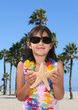 Girl at Beach Stock Images