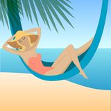 Girl on the beach. Pretty woman relaxing in hammock on the beach Royalty Free Stock Image