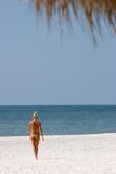 Girl on the Beach. Girl Walking on the Beach Royalty Free Stock Images