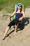Girl on the beach. Girl in her sun-chair on the beach Stock Photography