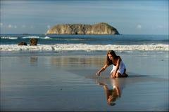 The girl on a beach. stock image