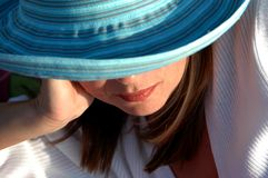 Girl At Beach. Girl relaxing at beach in sun hat Stock Photos