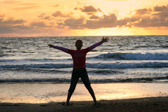 Girl on the beach. The running girl at the sunset Atlantic beach, France royalty free stock images