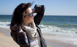 Girl on the beach. Smiling girl looks at the sea on a sunny day Royalty Free Stock Images