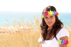 Girl at the beach. Young brunette girl at the beach Royalty Free Stock Images