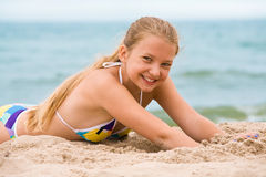 Girl on the beach. Girl with long blond hairs on the beach Stock Photography