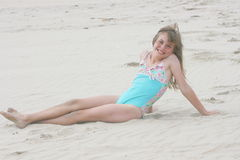 Girl on the beach. Blonde, laughing girl on the beach Stock Image