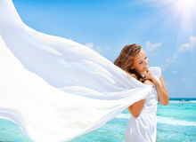 Girl on The Beach. Beautiful Girl With White Scarf on The Beach Stock Photo