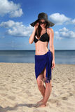 Girl on the beach. Beautiful girl in hat on the beach stock images
