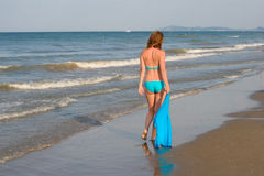 Girl on the beach. Girl is walking along the shore of the Mediterranean Sea Stock Photos