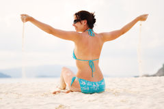 Girl on a beach stock images