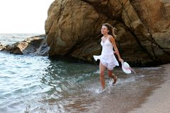 Girl on the beach. Beautiful  young girl runs after beach and uses holidays Stock Image