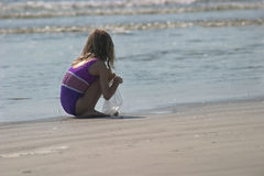Girl at beach. Girl searching for shells Royalty Free Stock Photos