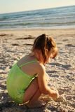 Girl on beach. At sunset Royalty Free Stock Image
