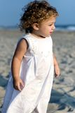 Girl on beach. Young girl walking on beach Royalty Free Stock Image