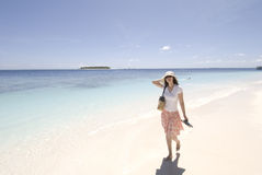 Girl on the beach. Mildives seascape on angsana ihuru island (angsana resort Stock Photos