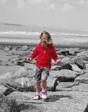 Girl on beach. With black and white background Royalty Free Stock Photo