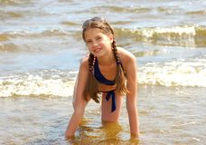 Girl on the beach. Beautiful girl on the sea coast Royalty Free Stock Image