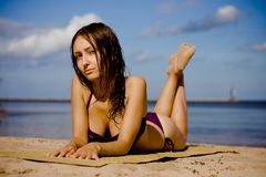 Girl on the beach. Girl lying on the beach Stock Photos