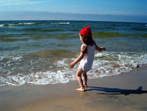 Girl in beach. A girl run to ocean stock image