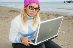 Girl on a beach. With a notebook Stock Images