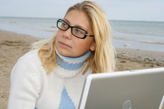 Girl on a beach. With a notebook Stock Image