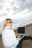 Girl on a beach. With a notebook royalty free stock images