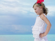 Girl on the beach. Pretty girl on the beach with flower Royalty Free Stock Images