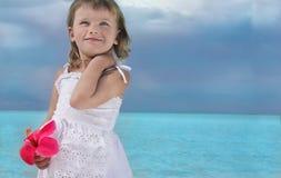 Girl on the beach. Cute girl with flower on the beach Royalty Free Stock Photos
