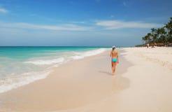 Girl on a beach Stock Image