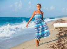 Girl on the beach alone Stock Photos
