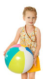 Girl on beach with ball Royalty Free Stock Images
