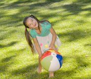Girl and Beach Ball Stock Photos
