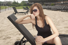 Girl in beach bar. Woman sitting on chair in beach bar in city center Royalty Free Stock Photo