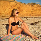Girl on the beach in a bathing suit Royalty Free Stock Photography