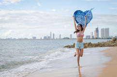 Girl on the beach. Beautiful lady playing on the beach Stock Photography