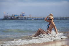 The girl on the beach. Beautiful girl lying on the beach Stock Photography