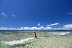 A girl on the beach Stock Image