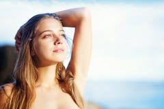 Girl on a beach Stock Photos