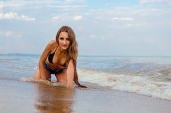 Girl on the beach. Beautiful girl sitting on the beach stock photo