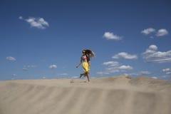 The girl on the beach. Beautiful woman run on the beach Royalty Free Stock Photo