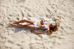 Girl on a beach Royalty Free Stock Images