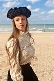 Girl beach black rose crown, De Panne, Belgium royalty free stock images