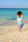 Girl on the beach Stock Image