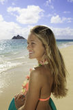 Girl on the beach with boogie board. Beautiful girl on the beach in bikini with boogie board Stock Photography