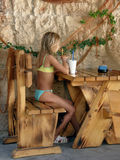Girl in beach cafe Stock Image