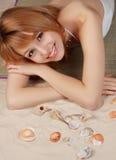 Girl on beach carpet Stock Images