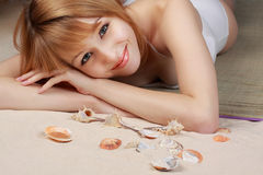 Girl on beach carpet Stock Images